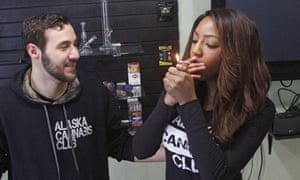 Charlo Greene shares a joint with Peter Lomonaco at the Alaska Cannabis Club.