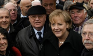 Mikhail Gorbachev and Angela Merkel join a crowd commemorating the 20th anniversary of the fall on the Berlin Wall