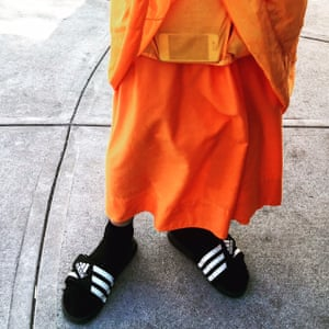 A mobile phone in a Monk's pocket. Somboon Rattanawerapong, 47, a buddhist monk from Thailand who lives in Arlington, Texas