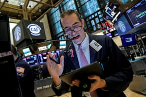 Traders on the floor at the New York Stock Exchange today.