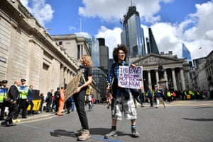 Climate change activists demonstrate outside the Bank of England