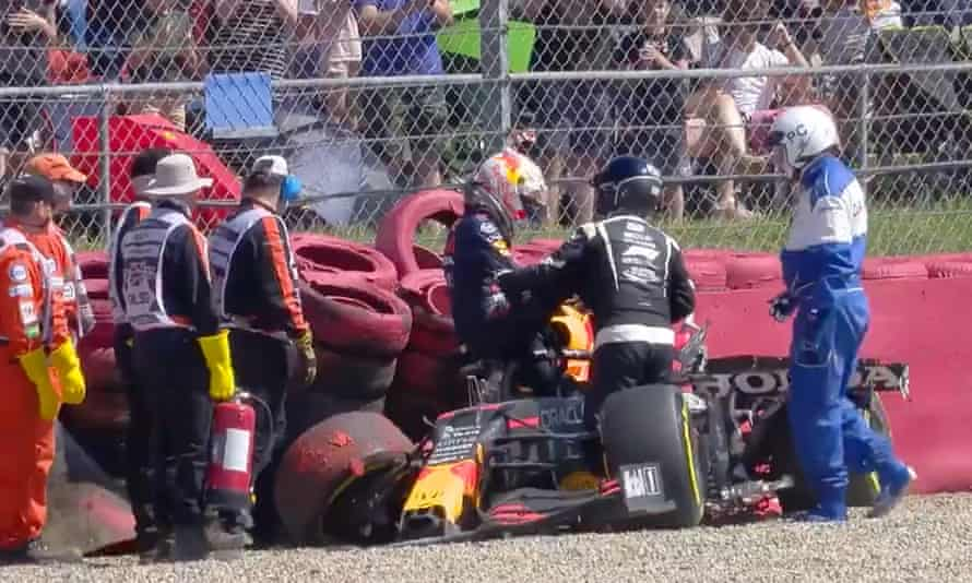 Max Verstappen climbs out of his car after the crash caused by Lewis Hamilton at Silverstone