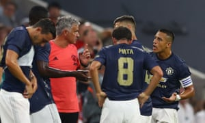 José Mourinho addresses his Manchester United players during a drinks break at the Allianz Arena.