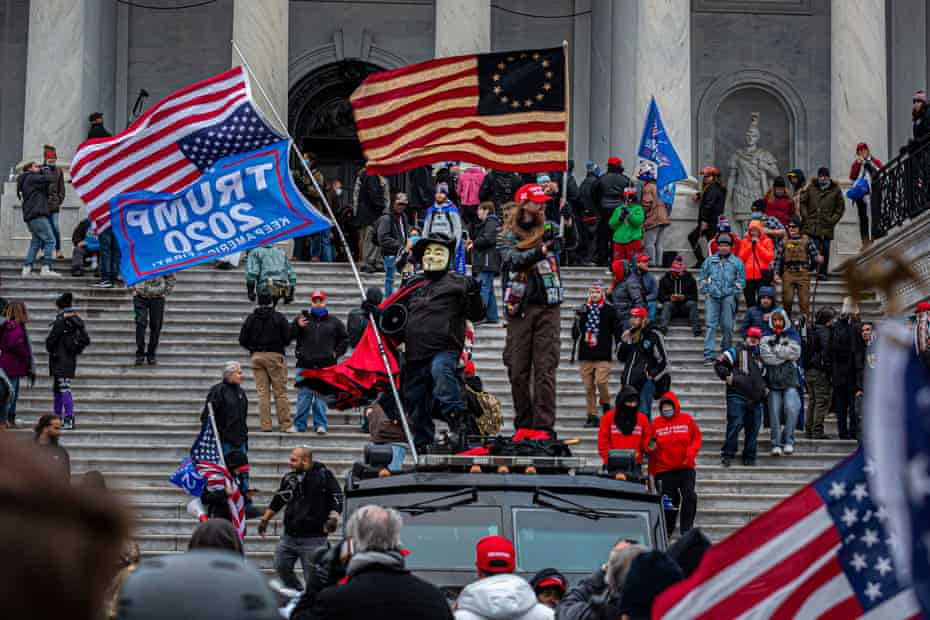 Pro-Trump mob breach the US Capitol building on 6 January.
