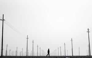 Man and electricity poles