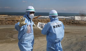 Contamination experts work at the site of the Fukushima disaster.
