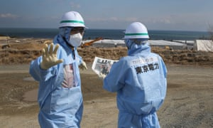 Workers oversee the decontamination and decommissioning process at Fukushima