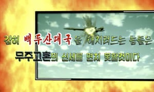 Image from propaganda video released by North Korea Tuesday shows a B-1B bomber hit by a missile.