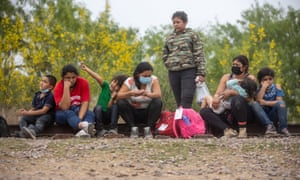 Migrant families wait to be processed at the border of the US and Mexico near Texas.