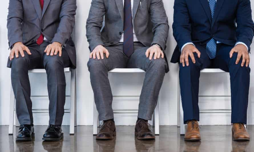 men in suits and ties sit on a bench