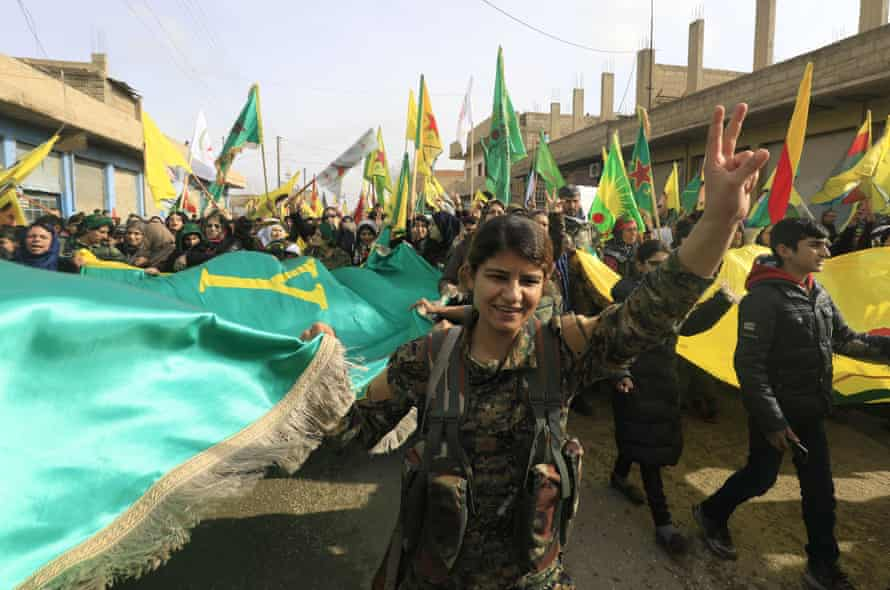 YPG members and Syrian Kurds take part in a demonstration in the town of Amuda, Syria, in January 2018.