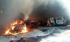 Vehicles burn, that authorities say caught fire during a gunbattle, in a warehouse at Rancho del Sol, near Ecuanduero, in western Mexico, on Friday.