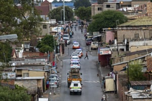 South African police and military patrol the Alexandra township