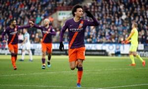 Manchester City's Leroy Sane celebrates scoring their third goal.