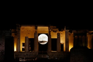 The full moon rises through the Propylaia of the ancient Acropolis hill in Athens