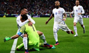Claudio Bravo is swamped by his Chile team-mates after thwarting Portugal in a penalty shootout to take his nation into the Confederations Cup final.