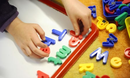 A child playing with letters