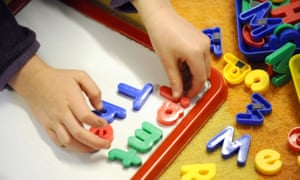 A child playing with letters of the alphabet