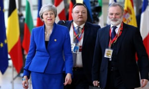 Theresa May (L) attends the EU Leaders Summit on Brexit at the European Council in Brussels.
