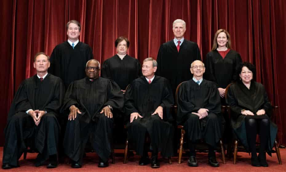 The US supreme court (left to right from back): Brett Kavanaugh, Elena Kagan, Neil Gorsuch, Amy Coney Barrett, Samuel Alito, Clarence Thomas, John Roberts, Stephen Breyer and Sonia Sotomayor.