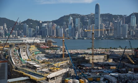 Labourers work on the new West Kowloon railway terminus.