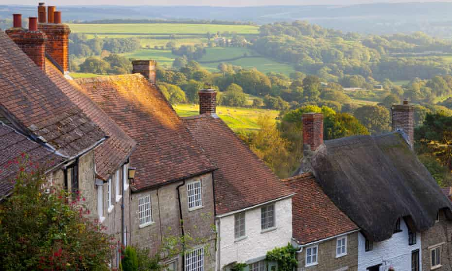 A row of houses with chimneys on a hill in Dorset, England