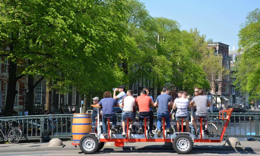 Tourists on one of the many beer bikes in Amsterdam.