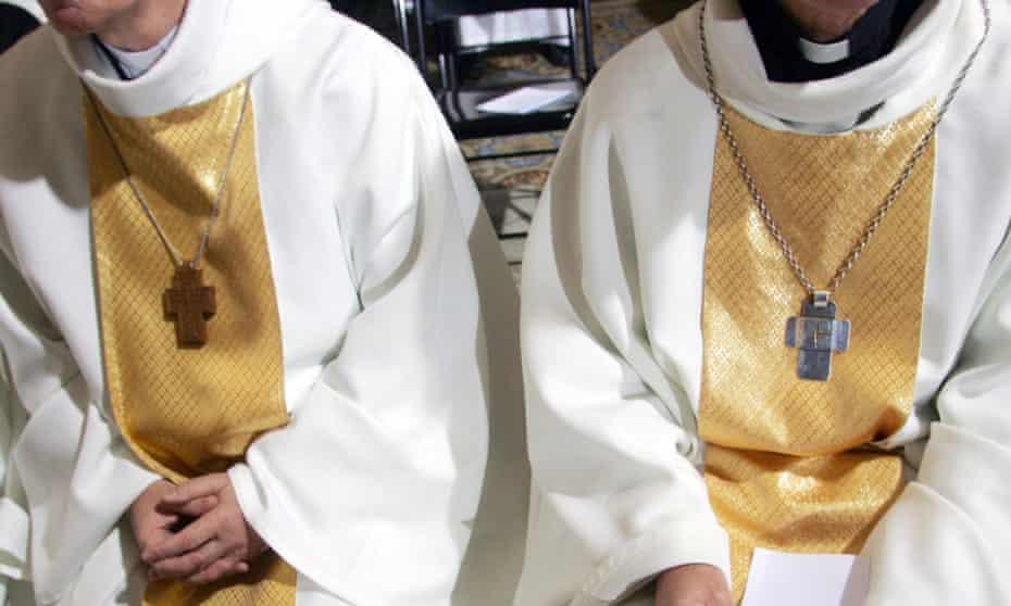 Bishops prepare to attend a mass.