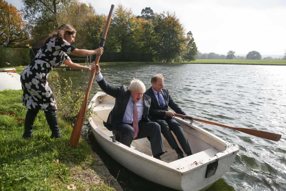 Lawyer and Johnson's wife, Marina Wheeler (left), helps as the then foreign secretary boards a rowing boat with the Czech Republic's deputy foreign minister, Ivo Sramek.