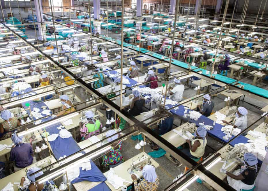 Factory workers are seen at the production unit for the production of personal protective equipment for COVID-19 coronavirus frontline health workers at a factory commissioned by the government, in Accra, on April 17, 2020.
