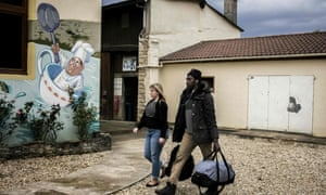 A migrant arrives from the Calais camp at the  Montlaville castle in Chardonnay.