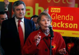 Britain's Prime Minister Gordon Brown listens as former actor and Labour Party MP Glenda Jackson speaks during a party meeting in a pub in Kilburn on May 2, 2010 in London