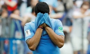 Uruguay's Luis Suarez looks dejected after the match.
