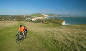 Cyclists on Tennyson Down, near Freshwater Bay, Isle of Wight, England, UK,