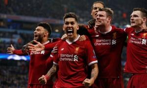 Liverpool's Roberto Firmino celebrates scoring the second.