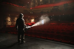 Seoul, South Korea: A worker sprays disinfectant as a precaution against coronavirus at the Sejong Centre for the Performing Arts.
