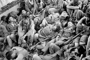 Exhausted South Vietnamese soldiers sleep on a US Navy troop carrier taking them back to the provincial capital of Ca Mau, August 1962. The infantry unit had been on a four-day operation against the Viet Cong in swamplands at the southern tip of the country