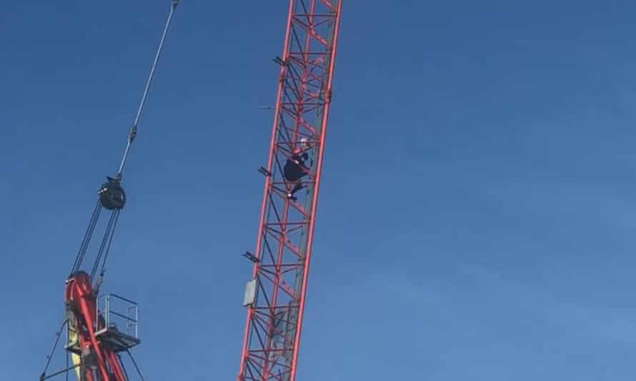 Alex Sidney scales a crane in Norwich.