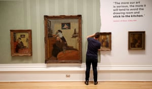 A gallery worker at National Museums Liverpool puts the finishing touches to a display of paintings by Walter Sickert as part of an exhibition of his work opening on Saturday 18 September