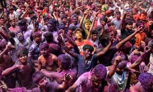 Guhawati, India. Revellers smeared in colour powder celebrate Holi, the spring festival of colours