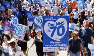 Marchers mark the 70th anniversary of the NHS in London, June 2018