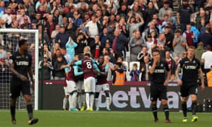 Diafra Sakho is mobbed by team-mates after scoring the only goal as Swansea players stand dejected.