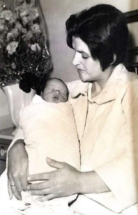 Malama holding her newborn second son Chris in 1969.