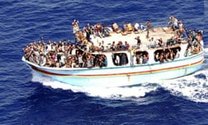 A handout picture made available by the Spanish Civil Guard (Guardia Civil) on 08 September 2015 of a small boat with an estimated 300 migrants on board as it was spotted and rescued in Italian waters some 150 miles south of Sicily.