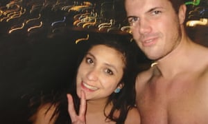 Warriena Wright and Gable Tostee pose for photos together on the balcony of his 14th floor Surfers Paradise apartment.