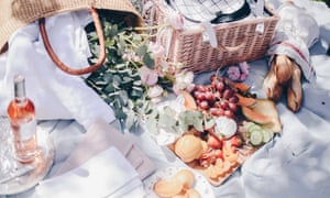 Picnic blanket and hamper of food and drink