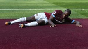West Ham's Michail Antonio celebrates scoring the opener by stroking the newly installed claret carpet at the London Stadium as the Hammers draw 2-2 with Leicester City.