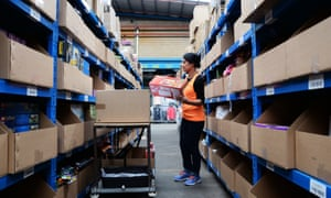 A worker prepares orders for shipment at Myer depot in Melbourne
