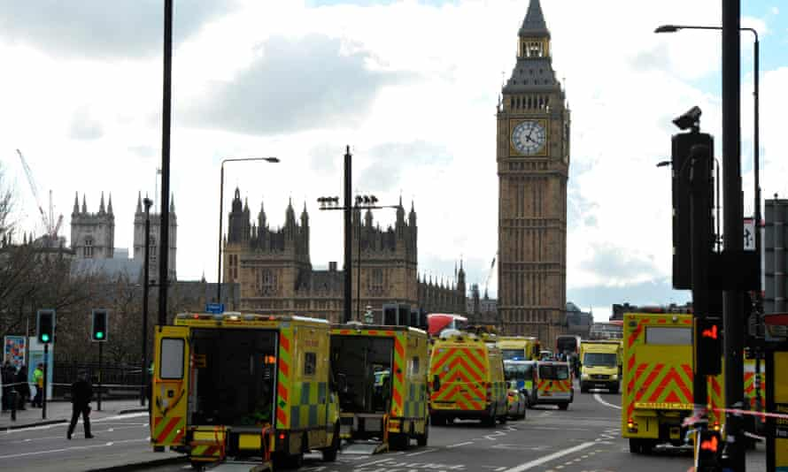 Members of the emergency services work to help victims on Westminster Bridge after the attack.