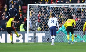 Tottenham's Paulo Gazzaniga dives to his right to save the penalty from Troy Deeney of Watford